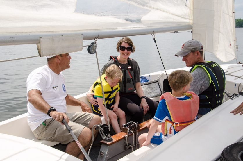 Family sailing in the interior of a Flying Scot